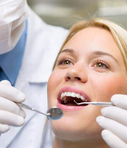 Woman having teeth cleaned